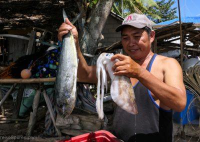 Fischer mit Ausbeute